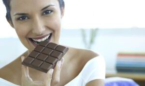 happy woman eating chocolate