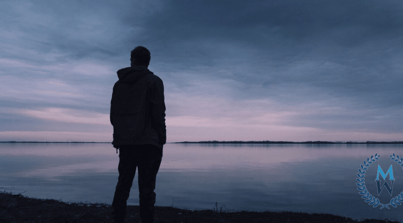 silhouette of man an beach