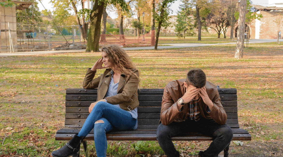 frustrated man and woman sitting on bench