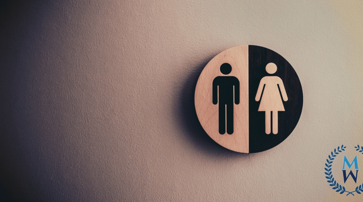 bathroom sign wiht female and male images