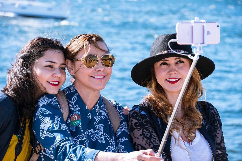 three woman taking a selfie