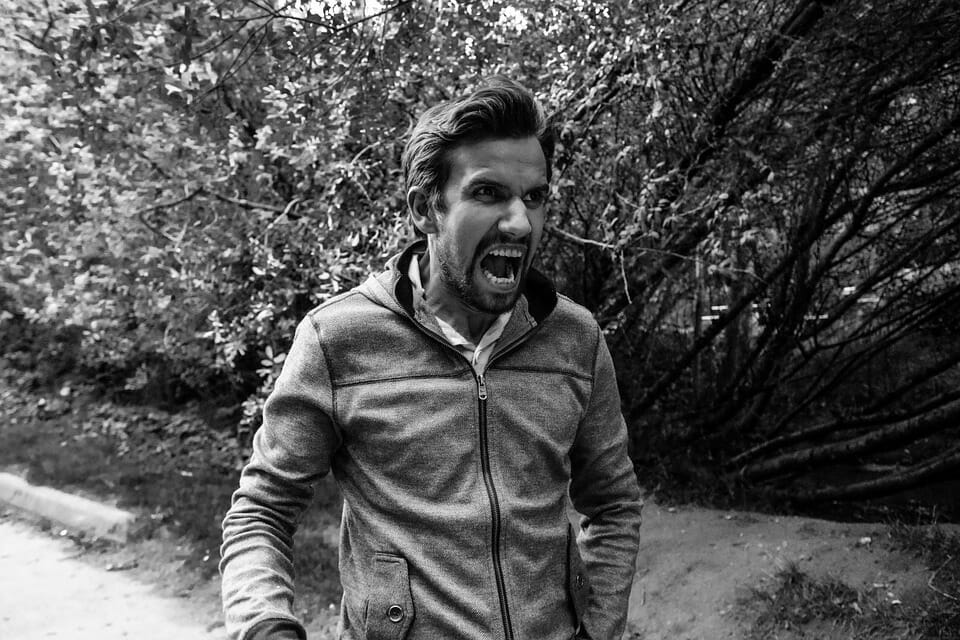 black and white picture of man yelling