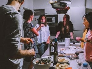 group of friends cooking and talking
