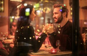 couple in love holding hands at a table