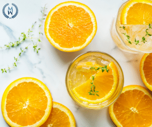 oranges and glasses of infused water ariel view