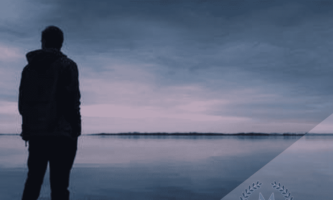 silhouette of man at beach at night