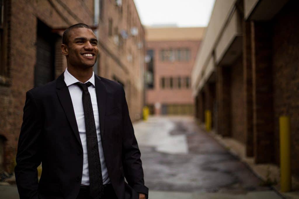 man in suit walking in ally