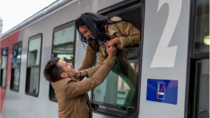 man and woman saying goodbye on train