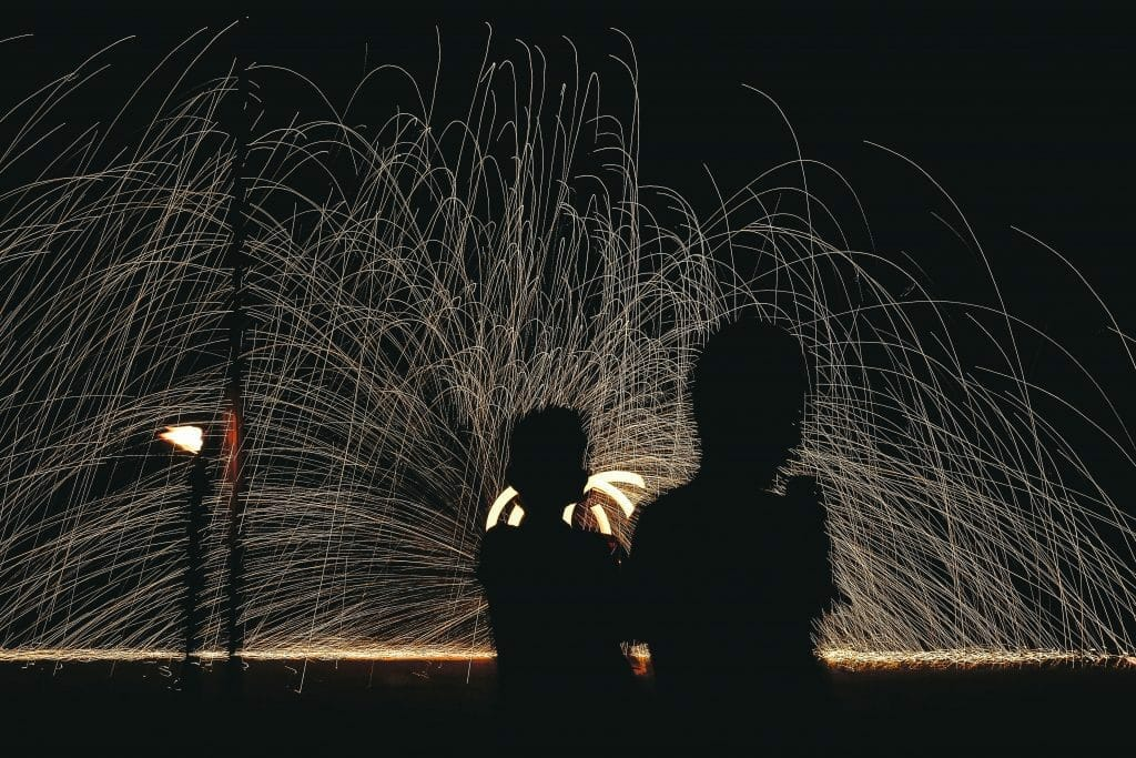 shadows of kids in front of fireworks