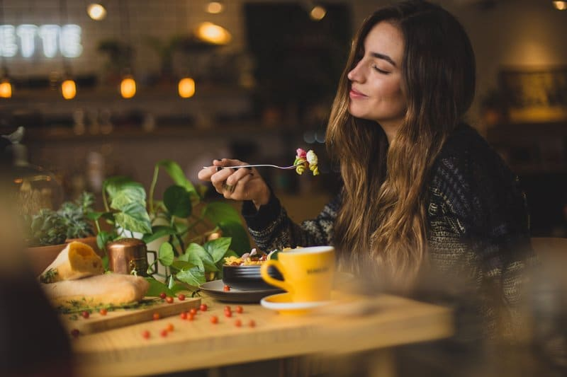 woman enjoying healthy meal